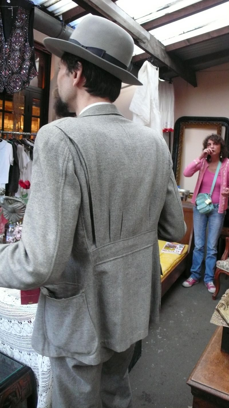 Rear of grey flannel suit